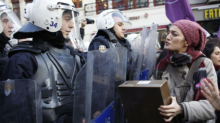 An activist for women's rights argues with riot police during a protest in Istanbul January 5, 2014. The activists, which included relatives of victims of domestic violence, were halted by riot police during their march along the main pedestrian street of Istiklal in central Istanbul. REUTERS/Murad Sezer (TURKEY - Tags: POLITICS CIVIL UNREST) - RTX172YV