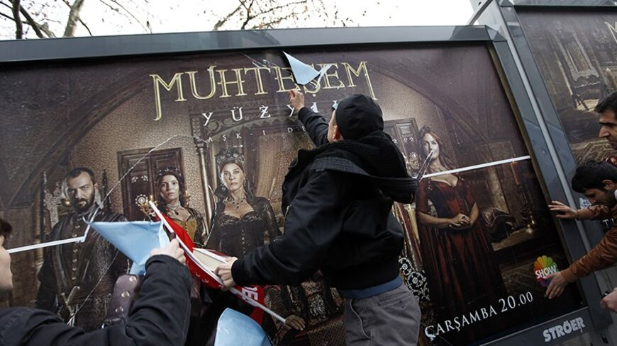 "Demonstrators throw eggs and attack billboards advertising the TV series ""The Magnificent Century"" during a protest near the Show TV headquarters in Istanbul January 9, 2011. A steamy television period drama about a 16th century sultan has angered conservative Muslims in Turkey and sparked a debate over the portrayal of the past in a country rediscovering its Ottoman heritage. ""The Magnificent Century"" chronicles the life of Suleiman the Magnificent, who ruled the Ottoman Empire during its golden age, showi"