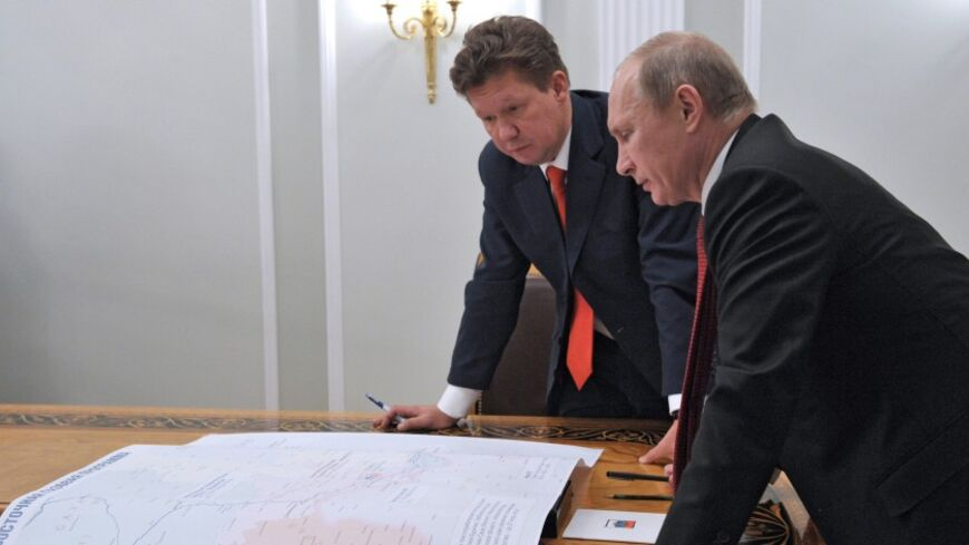 Russia's President Vladimir Putin (R) meets with Gazprom's Chief Executive Alexei Miller at the Novo-Ogaryovo residence outside Moscow, October 29, 2012. Russia's Gazprom pledged more than $38 billion (23.7 billion pounds) to develop an East Siberian gas field and build a pipeline to the Pacific port of Vladivostok to lessen its reliance on exports to Europe and develop Asian markets. REUTERS/Aleksey Nikolskyi/RIA Novosti/Pool (RUSSIA - Tags: POLITICS ENERGY BUSINESS) THIS IMAGE HAS BEEN SUPPLIED BY A THIRD