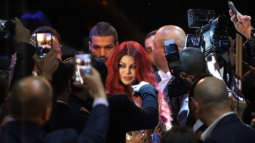 Lebanese pop star Haifa Wehbe arrives for the Premiere of he movie 'Halawet Rooh' at a movie theatre in the town of Dbayeh, North of Beirut on April 8 , 2014. AFP PHOTO/JOSEPH EIDEID        (Photo credit should read JOSEPH EID/AFP/Getty Images)