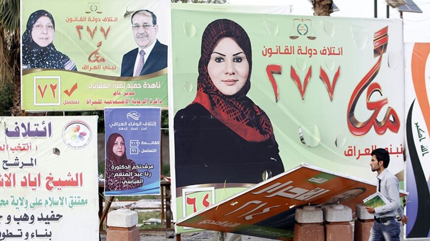 "A man walks past election posters of Iraqi women candidates in Baghdad, April 24, 2014.  As Iraq's general election draws closer, both men and women are vying for seats in the country's parliament. But this year's election, the first one after the withdrawal of U.S troops in 2011, has seen an increase in the number of female candidates. According to an Iraqi election official, women make up around 30 to 35 percent of the candidates in the April 30 election. ""The total number of nominees in the 2010 parliame"
