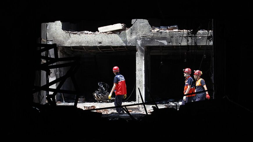 Search and rescue officers work at a damaged building at the site of blast in the town of Reyhanli in Hatay province, near the Turkish-Syrian border, May 14, 2013. REUTERS/Umit Bektas (TURKEY - Tags: POLITICS CIVIL UNREST) - RTXZLWH