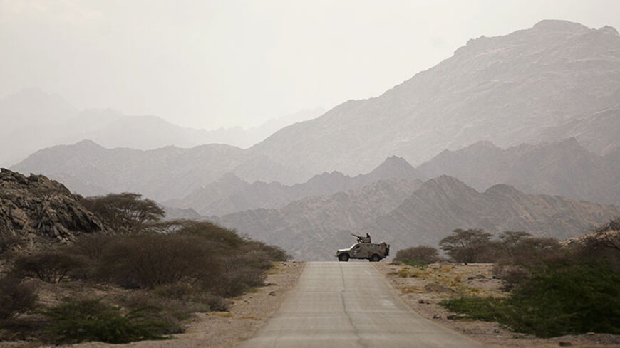 An army vehicle patrols in al-Mahfad of the southern Yemeni province of Abyan May 23, 2014. Yemeni forces have faced a wave of hit-and-run attacks by al Qaeda insurgents since the army captured their strongholds in al-Mahfad in Abyan province and in Mayfa'a, Azzan and Gol al-Rayda in Shabwa province earlier this month. Picture taken May 23, 2014. REUTERS/Khaled Abdullah (YEMEN - Tags: POLITICS MILITARY CIVIL UNREST TPX IMAGES OF THE DAY) - RTR3QMO6