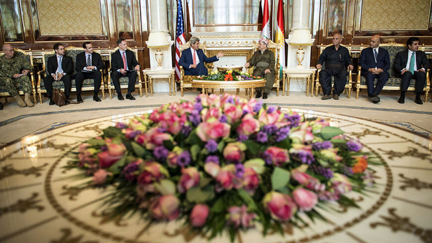 Kurdistan Regional Government President Massoud Barzani (centre, R) meets with U.S. Secretary of State John Kerry (centre, L) at the presidential palace in Arbil, the capital of northern Iraq's Kurdistan autonomous region, June 24, 2014. Kerry was in Iraqi Kurdistan on Tuesday to urge its leaders not to withdraw from the political process in Baghdad after their forces took control of the northern oil city of Kirkuk. Peshmerga fighters, the security forces of Iraq's autonomous Kurdish north, seized control o