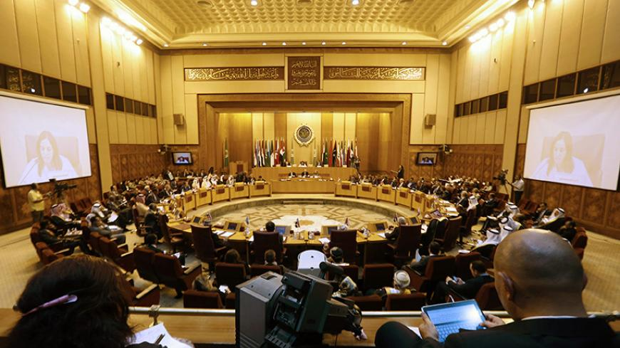 A general view of the venue during an extraordinary session of the Arab League at the league's headquarters in Cairo July 14, 2014. Egypt launched an initiative on Monday to halt fighting between Israel and Palestinian militants, proposing a ceasefire to be followed by talks in Cairo on settling the conflict in which Gaza authorities say more than 170 people have died. REUTERS/Amr Abdallah Dalsh (EGYPT - Tags: POLITICS CIVIL UNREST) - RTR3YNOV