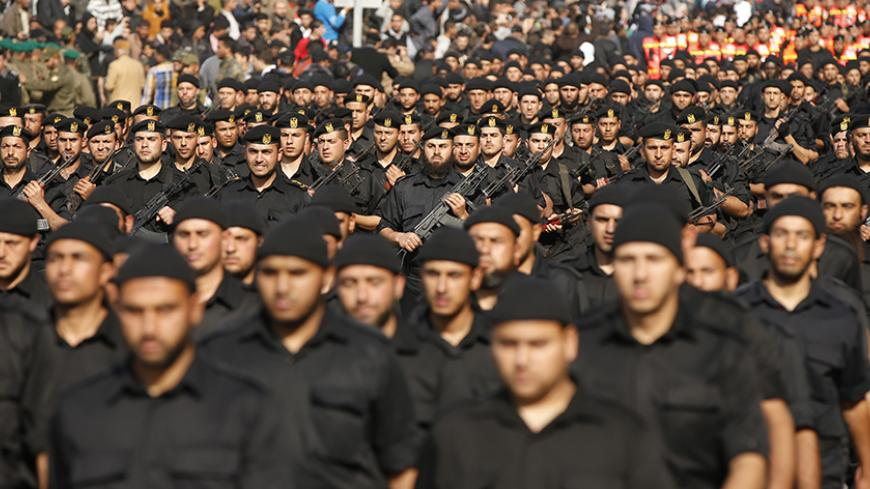 Members of the Palestinian security forces loyal to Hamas movement take part in a parade marking the fifth anniversary of the three-week offensive Israel launched in 2008-2009, in Gaza City January 13, 2014. REUTERS/Mohammed Salem (GAZA - Tags: POLITICS MILITARY ANNIVERSARY) - RTX17CGS