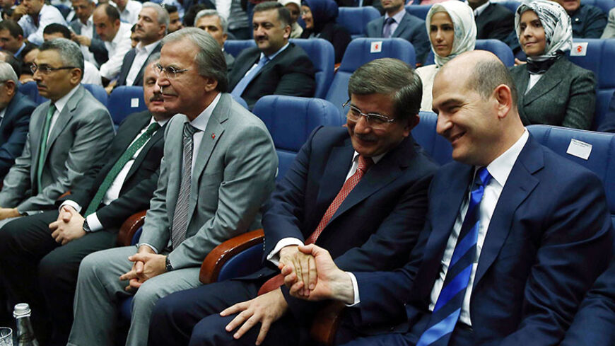 Turkish Foreign Minister Ahmet Davutoglu (2nd-R) is congratulated after being named prime minister and leader of the Justice and Development Party (AKP) during a party meeting in Ankara on August 21, 2014. Turkey's president-elect Recep Tayyip Erdogan named Davutoglu to succeed him as ruling party leader and prime minister, promoting an ally who is expected to show unstinting loyalty to the new head of state. AFP PHOTO/ADEM ALTAN        (Photo credit should read ADEM ALTAN/AFP/Getty Images)