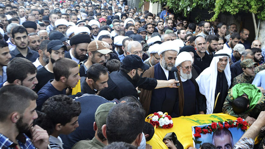 Lebanon's senior Hezbollah official Sheikh Nabil Qawouq leads the payers around the coffin of Ibrahim al-Haj, a Hezbollah commander who died during a mission in Iraq, during his funeral in Mashghara village in the Bekaa Valley July 30, 2014. A Hezbollah commander has died during a mission in Iraq, sources familiar with the incident said on Wednesday, indicating the Lebanese group that is already fighting in Syria's civil war may be involved in a second conflict in the region. Four sources in Lebanon named t