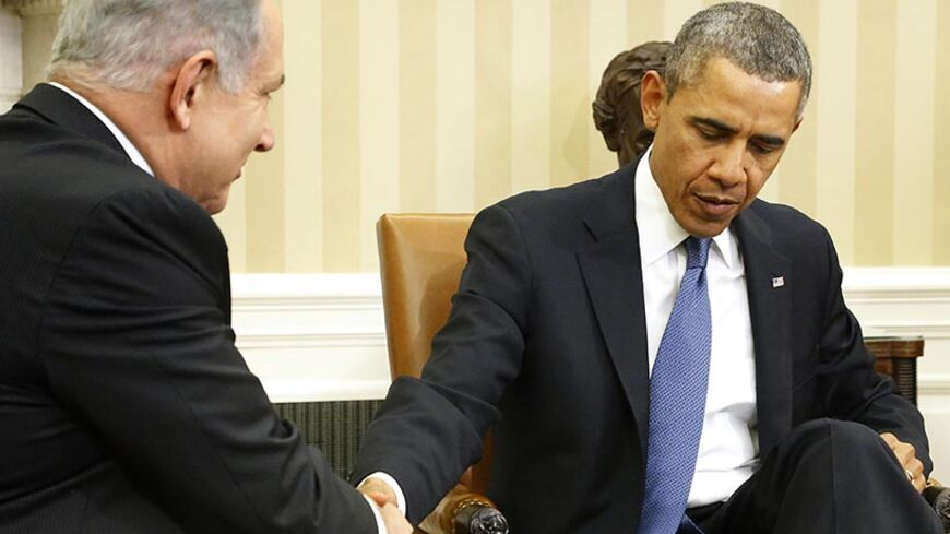 U.S. President Barack Obama (R) shakes hands with Israel's Prime Minister Benjamin Netanyahu as they sit down to meet in the Oval Office of the White House in Washington March 3, 2014.   REUTERS/Jonathan Ernst    (UNITED STATES - Tags: POLITICS) - RTR3G01E