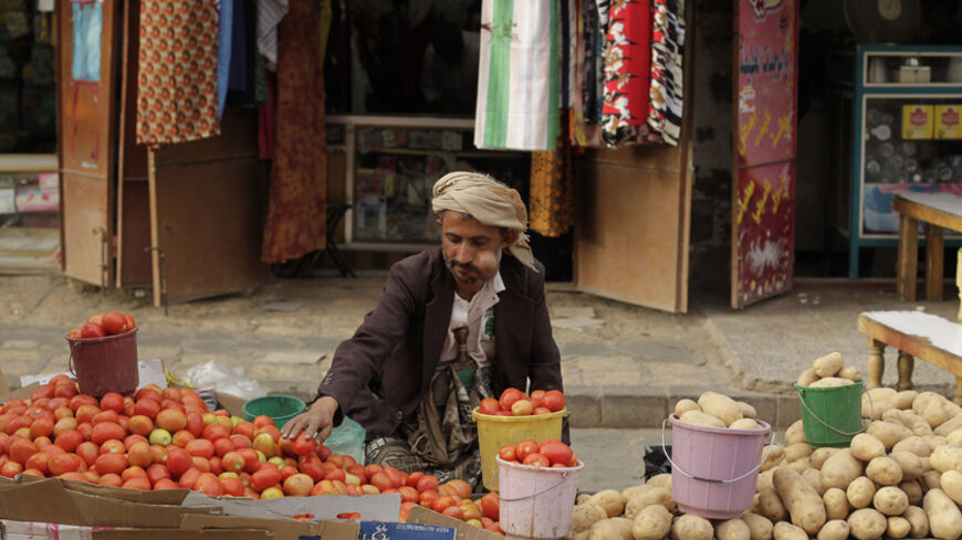 A street vendor chews qat, a mild stimulant, as he sits by his vegetable stall at a market place in the Old Sanaa city March 19, 2014. Qat dominates life in Yemen, where most men spend half the day chewing it, even at work, and experts say it is ravaging Yemen's frail economy and sucking up precious water. REUTERS/Khaled Abdullah (YEMEN - Tags: SOCIETY ENVIRONMENT) - RTR3HSAZ