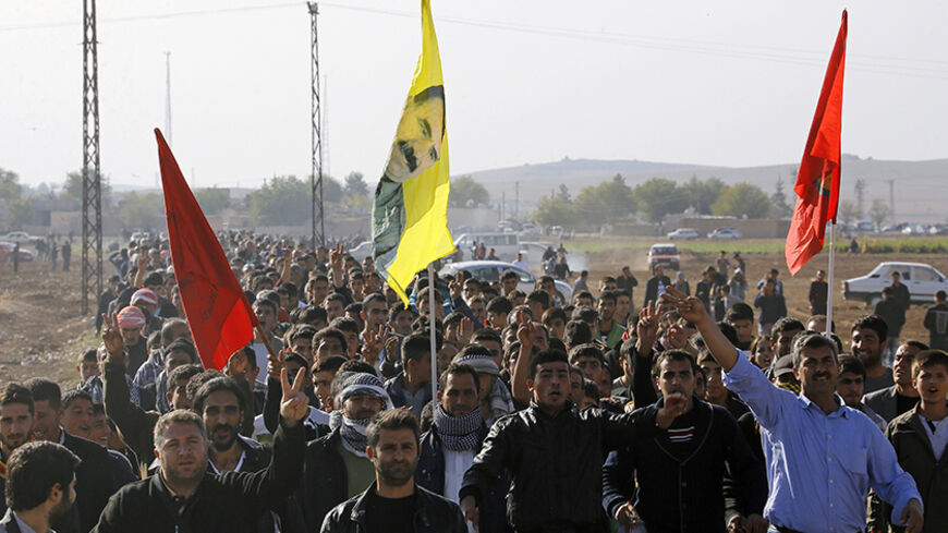 Kurdish civilians march by the Turkish-Syrian border village of Caycara to protest against Islamic State, during a rally in solidarity with the people of the Syrian Kurdish town of Kobani, November 1, 2014.REUTERS/Yannis Behrakis (TURKEY - Tags: CIVIL UNREST MILITARY POLITICS CONFLICT) - RTR4CFSC