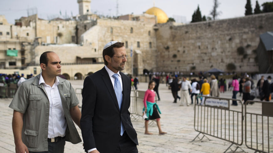Israeli parliament member from the Likud party Moshe Feiglin (R) walks near the Western Wall after visiting the compound known to Muslims as Noble Sanctuary and to Jews as Temple Mount in Jerusalem's Old City November 2, 2014. Feiglin, a far-right politician who wants Jews to be allowed to pray at Jerusalem's al-Aqsa compound, visited the site on Sunday, defying Prime Minister Benjamin Netanyahu's calls for restraint after clashes this week between Israeli police and Palestinians. REUTERS/Amir Cohen (JERUSA