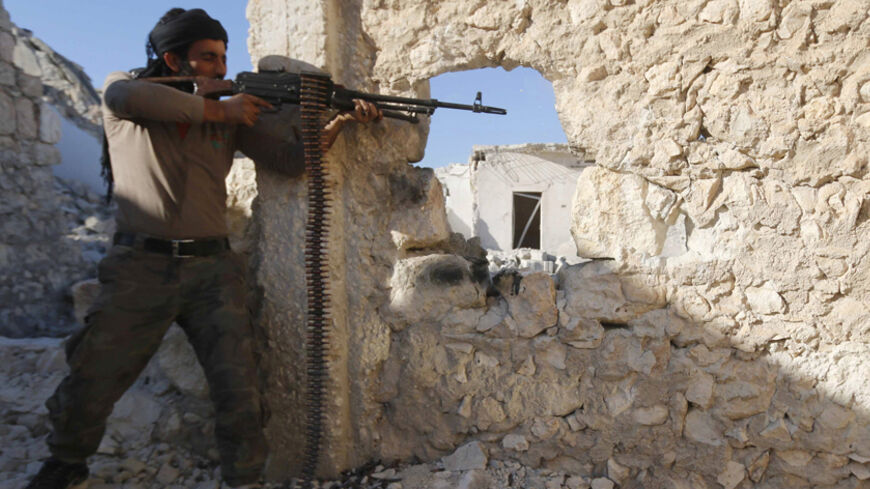 A Free Syrian Army fighter fires his weapon during clashes with forces loyal to Syria's President Bashar al-Assad in the Handarat area, north of Aleppo November 6, 2014. REUTERS/Hosam Katan (SYRIA - Tags: CIVIL UNREST CONFLICT) - RTR4D5F0