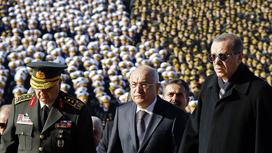 Turkish President Tayyip Erdogan (R), Speaker of the Turkish parliament Cemil Cicek and Chief of Staff General Necdet Ozel (L) attend a ceremony at the mausoleum of Mustafa Kemal Ataturk, marking the anniversary of his death, in Ankara November 10, 2014. Thousands of Turks visited Ataturk's mausoleum on his 76th death anniversary. Ataturk, the first president of Turkey from 1923 and founder of the modern secular state, died on November 10, 1938. He was 57. REUTERS/Umit Bektas (TURKEY - Tags: POLITICS ANNIVE