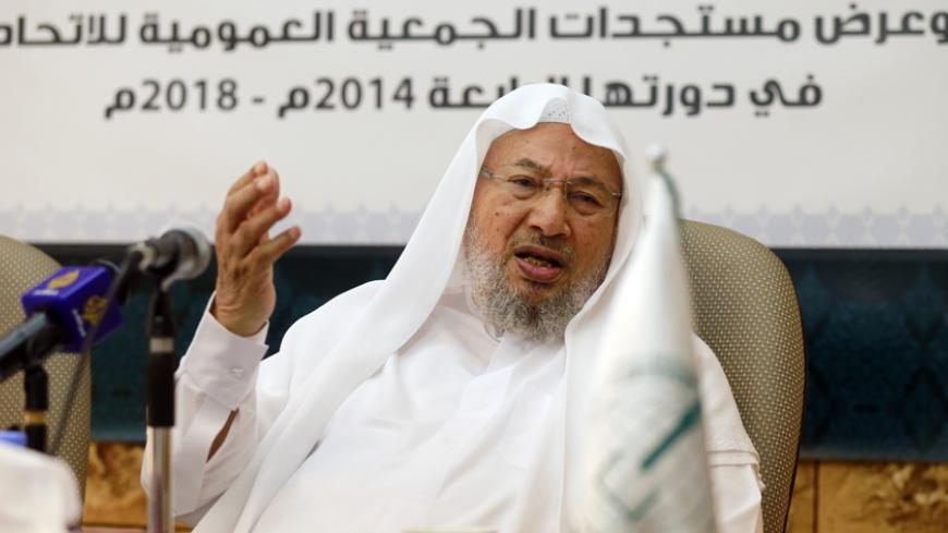 Chairman of the International Union of Muslim Scholars Youssef al-Qaradawi speaks during a news conference in Doha June 23, 2014. The influential Sunni Muslim cleric said on Monday that only dialogue could solve Iraq's crisis, sounding a conciliatory note on the threat posed by Sunni Islamist insurgents that could further polarise the Middle East along sectarian lines. Picture taken June 23.     REUTERS/Mohammed Dabbous (QATAR - Tags: RELIGION POLITICS CIVIL UNREST) - RTR3VSK2