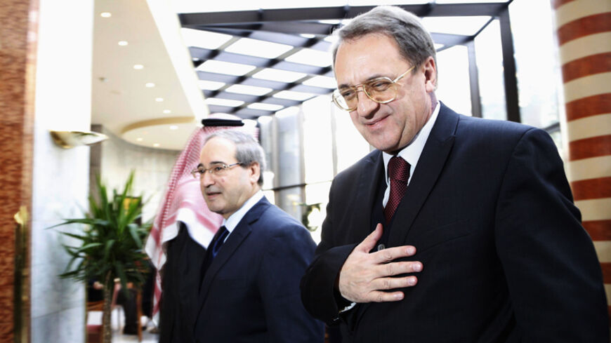 Russia's Deputy Foreign Minister Mikhail Bogdanov (R) walks with Syria's Deputy Foreign Minister Faisal al-Miqdad upon his arrival in Damascus December 10, 2014. REUTERS/Omar Sanadiki   (SYRIA - Tags: POLITICS) - RTR4HEWY