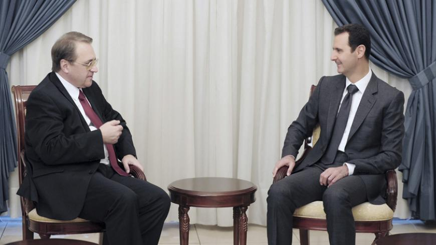 Syria's President Bashar al-Assad (R) meets Russia's Deputy Foreign Minister Mikhail Bogdanov in Damascus December 10, 2014 in this picture released by Syria's national news agency SANA. REUTERS/SANA/Handout via Reuters (SYRIA - Tags: CIVIL UNREST POLITICS CONFLICT)   ATTENTION EDITORS - THIS PICTURE WAS PROVIDED BY A THIRD PARTY. REUTERS IS UNABLE TO INDEPENDENTLY VERIFY THE AUTHENTICITY, CONTENT, LOCATION OR DATE OF THIS IMAGE. FOR EDITORIAL USE ONLY. NOT FOR SALE FOR MARKETING OR ADVERTISING CAMPAIGNS. T