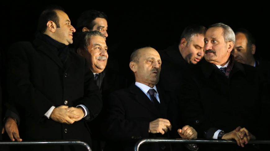 (L-R) Turkey's European Affairs Minister Egemen Bagis, Interior Minister Muammer Guler, Environment and City Planning Minister Erdogan Bayraktar and Economy Minister Zafer Caglayan wait for the arrival of the prime minister at Esenboga Airport in Ankara December 24, 2013. Turkish ministers Caglayan and Guler resigned on Wednesday after their sons were arrested in a corruption investigation that has pitted the government against the judiciary and rattled foreign investors. Guler and Caglayan each had a son a