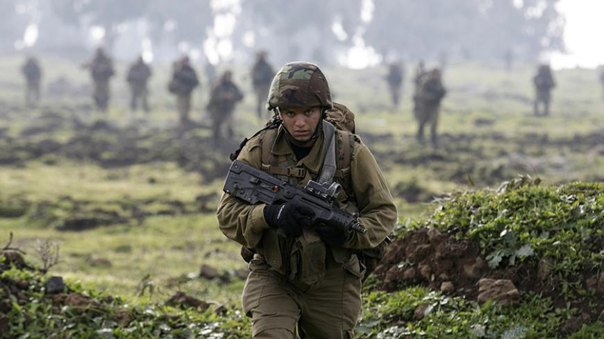An Israeli soldier from the Golani brigade takes part in training near the city of Katzrin in the Golan Heights January 19, 2015. An Israeli helicopter strike in Syria killed a commander from Lebanon's Hezbollah and the son of the group's late military leader Imad Moughniyah, Hezbollah said, in a major blow that could lead to reprisal attacks.The strike hit a convoy carrying Jihad Moughniyah and commander Mohamad Issa, known as Abu Issa, in the province of Quneitra, near the Israeli-occupied Golan Heights,