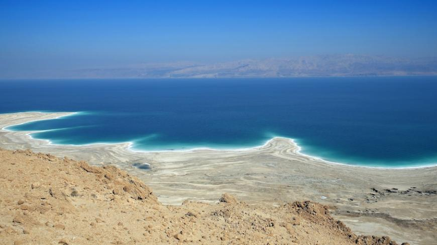 A picture taken on February 8, 2014 near Ein Gedi, in Israel shows the Dead Sea shoreline shaped by the decline in water levels as a result of the drying up. The Dead Sea, 400 meters below sea level, is the lowest point on earth and its mineral-rich waters and shores have been celebrated for their cleansing, healing and therapeutic properties. In the background is the Jordanian coast.   AFP PHOTO  THOMAS COEX        (Photo credit should read THOMAS COEX/AFP/Getty Images)