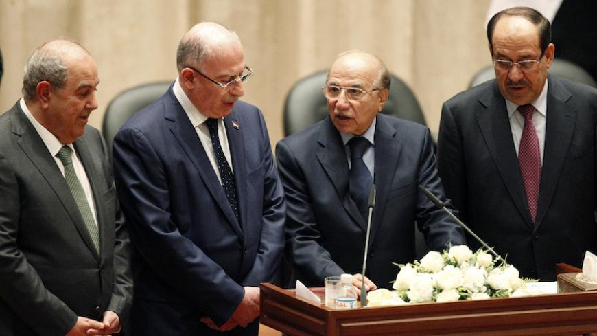 Iyad Allawi (L), Usama al-Nujaifi (2nd L), Iraq's supreme court judge Midhat al-Mahmoud (2nd R) and Nuri al-Maliki (R) stand together during a swearing-in at the parliament headquarters in Baghdad September 8, 2014. Iraq's parliament approved a new government headed by Haider al-Abadi as prime minister on Monday night, in a bid to rescue Iraq from collapse, with sectarianism and Arab-Kurdish tensions on the rise. The parliament approved for the ceremonial posts of vice presidents the last prime minister al-