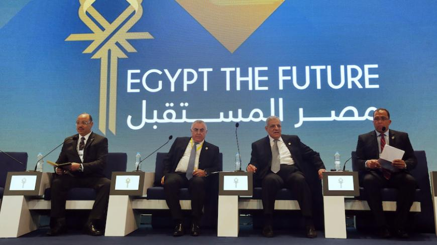 Egypt's Finance Minister Hany Dimian (L-R), central bank governor Hisham Ramez, Prime Minister Ibrahim Mehleb and Planning Minister Ashraf al-Arabi attend the Egypt Economic Development Conference (EEDC) in Sharm el-Sheikh, in the South Sinai governorate, south of Cairo, March 14, 2015. Gulf Arab allies pledged a further $12 billion of investments and central bank deposits for Egypt at an international summit on Friday, a big boost to President Abdel Fattah al-Sisi as he tries to reform the economy after ye