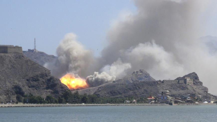 An arms depot explodes at the Jabal Hadeed military compound in Yemen's southern port city of Aden March 28, 2015. Explosions rocked Aden's largest arms depot on Saturday, sending flames and smoke into the sky above the southern Yemeni city, witnesses said. A Reuters correspondent saw fire and explosions at the Jabal Hadeed compound, which is close to residential and commercial properties. There was no immediate word of casualties. REUTERS/Nabeel Quaiti      TPX IMAGES OF THE DAY      - RTR4V93W