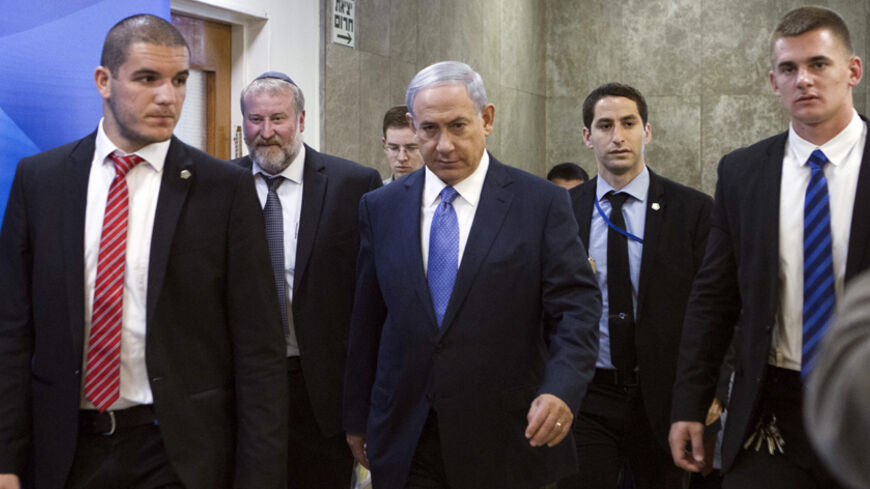Israel's Prime Minister Benjamin Netanyahu (C) arrives to the weekly cabinet meeting in Jerusalem March 29, 2015. Netanyahu condemned on Sunday the framework Iranian nuclear agreement being sought by international negotiators, saying it was even worse than his country had feared. REUTERS/Dan Balilty/Pool  - RTR4VCEV