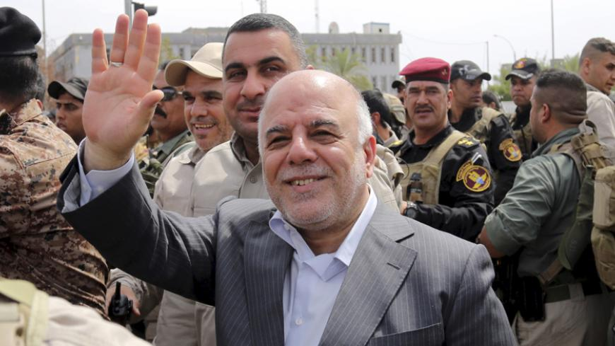 Iraq's Prime Minister Haidar al-Abadi tours the city of Tikrit after Iraq security forces regained control from Islamist State militants, April 1, 2015. Iraqi troops and Shi'ite paramilitary fighters were battling Islamic State on Wednesday in northern Tikrit, which officials described as the Sunni Muslim militant group's last stronghold in the city. REUTERS/Stringer - RTR4VSL0