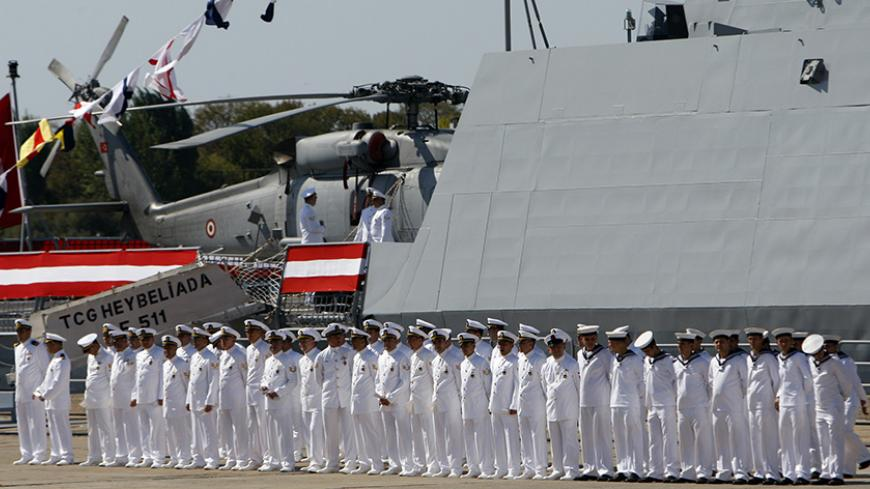 Navy officers attend a delivery ceremony for the first nationally designed combat ship TCG Heybeliada at the Tuzla Naval shipyard in Istanbul September 27, 2011.  REUTERS/Osman Orsal (TURKEY - Tags: POLITICS MILITARY) - RTR2RWMP