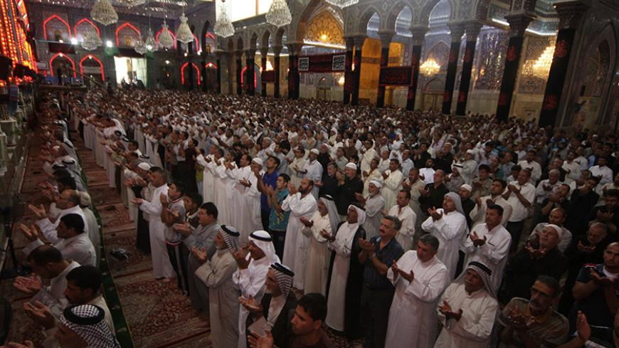 Shi'ite Muslims attend Friday prayers at the Imam Hussein shrine in the holy city of Kerbala July 18, 2014. Iraq's top Shi'ite Muslim cleric criticised the government and international agencies on Friday for failing to do enough to help hundreds of thousands of civilians displaced by fighting between government forces and Sunni Islamist insurgents. REUTERS/Mushtaq Muhammed (IRAQ - Tags: CIVIL UNREST POLITICS RELIGION) - RTR3Z7IR