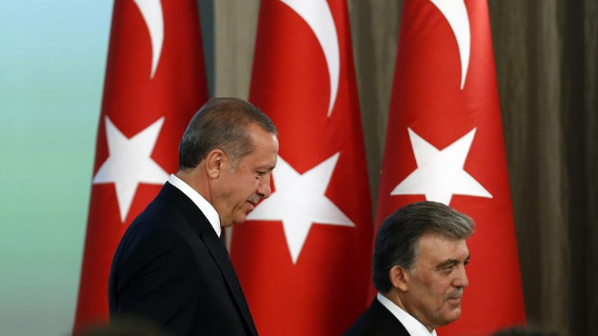 Turkey's new President Tayyip Erdogan (L) and outgoing President Abdullah Gul attend a handover ceremony at the Presidential Palace of Cankaya in Ankara August 28, 2014. Erdogan was sworn in as Turkey's 12th president at a ceremony in parliament on Thursday, cementing his position as the country's most powerful modern leader, in what his opponents fear will herald an increasingly authoritarian rule. REUTERS/Umit Bektas (TURKEY - Tags: POLITICS) - RTR444T5