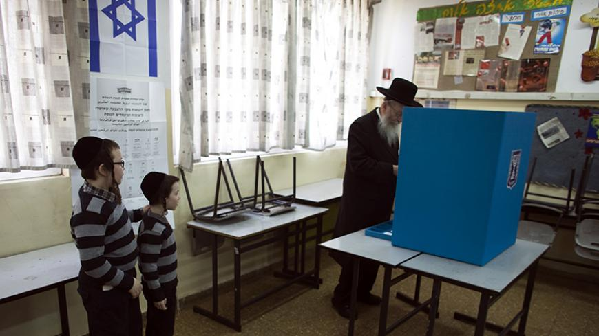 Israeli parliament member Yaakov Litzman stands at a voting booth as he casts his ballot at a polling station in Jerusalem March 17, 2015. Millions of Israelis voted on Tuesday in a tightly fought election, with Prime Minister Benjamin Netanyahu facing an uphill battle to defeat a strong campaign by the centre-left opposition to deny him a fourth term in office. REUTERS/Ronen Zvulun (JERUSALEM - Tags: POLITICS ELECTIONS) - RTR4TNNN