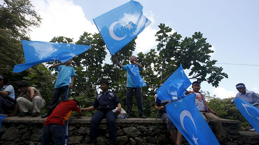 "Boys wave East Turkestan flags during a protest against China near the Chinese Consulate in Istanbul, Turkey, July 5, 2015. China warned its citizens travelling in Turkey to be careful of anti-Beijing protests, warning them that some Chinese tourists have recently been ""attacked and disturbed"". The notice, posted on the Ministry of Foreign Affairs website on Sunday, said that there have recently been ""multiple"" demonstrations in Turkey targeting the Chinese government. The notice gave no details regarding t"