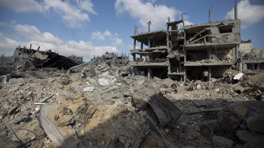 A view of the rubble of destroyed buildings and homes in the Shejaiya residential district of Gaza City on July 26, 2014. The bodies of at least 35 Palestinians were recovered from rubble across Gaza in the three hours since a humanitarian truce came into effect, raising to over 900 the overall death toll of Israel's onslaught on the territory since July 8, medics said. Thirteen bodies were recovered in Shejaiya in eastern Gaza City, 13 more in Deir al-Balah and Nusseirat in central Gaza, and nine in north