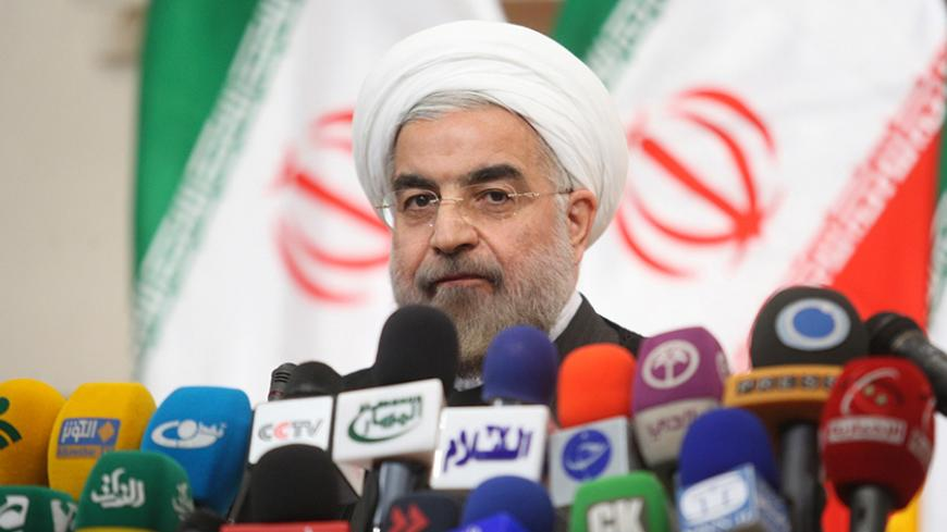 Iranian President-elect Hassan Rouhani speaks with the media during a news conference in Tehran June 17, 2013.   REUTERS/Fars News/Majid Hagdost  (IRAN - Tags: POLITICS PROFILE) ATTENTION EDITORS - THIS IMAGE WAS PROVIDED BY A THIRD PARTY. FOR  EDITORIAL USE ONLY. NOT FOR SALE FOR MARKETING OR ADVERTISING CAMPAIGNS. THIS PICTURE IS DISTRIBUTED EXACTLY AS RECEIVED BY REUTERS, AS A SERVICE TO CLIENTS - RTX10QW5