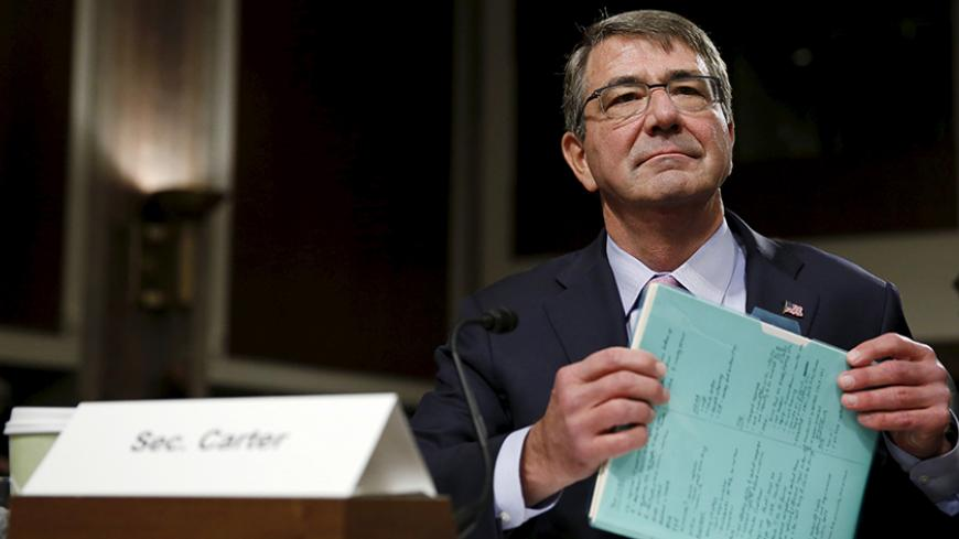 "United States Secretary of Defense Ash Carter prepares to testify at a Senate Armed Forces Committee hearing on ""United States Strategy in the Middle East"" in Washington October 27, 2015. REUTERS/Gary Cameron     - RTX1TGBO"