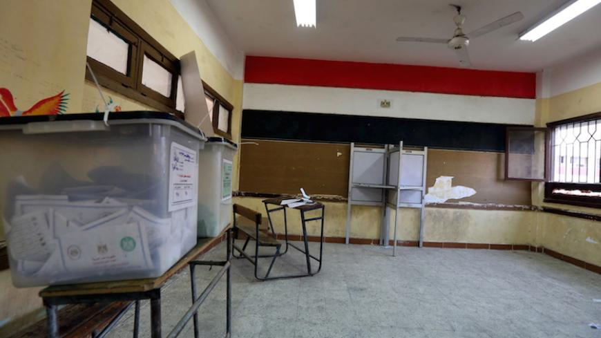 An empty polling station is seen during the second round of parliamentary election at Shubra area in Cairo, Egypt, November 23, 2015.  REUTERS/Mohamed Abd El Ghany - RTX1VGQP