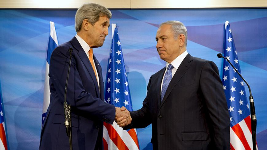 U.S. Secretary of State John Kerry (L) shakes hands with Israeli Prime Minister Benjamin Netanyahu before their meeting at the Prime Minister's Office in Jerusalem, November 24, 2015.  REUTERS/Jacquelyn Martin/Pool - RTX1VJZM