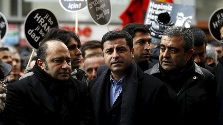 Co-chair of the pro-Kurdish Peoples' Democratic Party (HDP), Selahattin Demirtas (C) attends a ceremony to mark the ninth anniversary of the killing of Turkish-Armenian editor Hrant Dink in Istanbul January 19, 2016. REUTERS/Osman Orsal - RTX232RL
