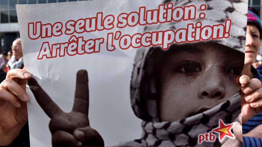 "A protester holds a sign, which reads: ""Only one solution: stop occupation"", during a demonstration in solidarity with Palestinians, in Brussels, Belgium, October 18, 2015. REUTERS/Eric Vidal - RTS4Z1P"