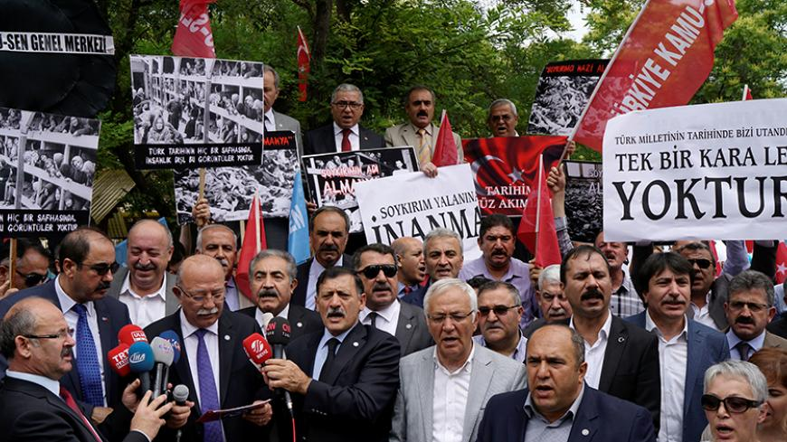 "Turkish demonstrators stage a protest against approval of a resolution by Germany's parliament that declares the 1915 massacre of Armenians by Ottoman forces a ""genocide"" in front of the German Embassy in Ankara, Turkey, June 3, 2016. REUTERS/Umit Bektas - RTX2FHV5"