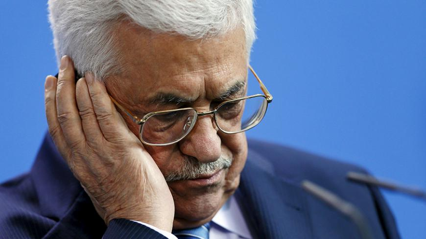 Palestinian President Mahmoud Abbas listens through headphones during a news conference with Chancellor Angela Merkel (unseen) at the Chancellery in Berlin, Germany, April 19, 2016. REUTERS/Hannibal Hanschke  - RTX2AOLK