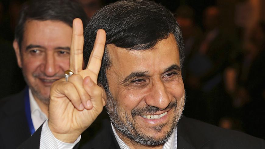 "Iranian President Mahmoud Ahmadinejad gestures to photographers after meeting with Indonesian counterpart Susilo Bambang Yudhoyono in Nusa Dua, Bali November 9, 2012. Ahmadinejad said on Thursday the age of nuclear deterrence was long gone and any country still stockpiling nuclear weapons was ""mentally retarded"". He again denied Iran was trying to develop nuclear weapons, a day after the re-election victory of U.S. President Barack Obama, for whom Tehran's disputed nuclear programme will be one of the thorn"