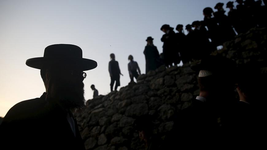 "Ultra-Orthodox Jews take part in the ""Mayim Shelanu"" ceremony to collect water from a natural spring, near Jerusalem April 21, 2016. The water is used to make matza, the traditional unleavened bread to be eaten on the Jewish holiday of Passover which starts on Friday. Passover commemorates the flight of Jews from ancient Egypt, as described in the Exodus chapter of the Bible. REUTERS/Ronen Zvulun - RTX2B2U8"