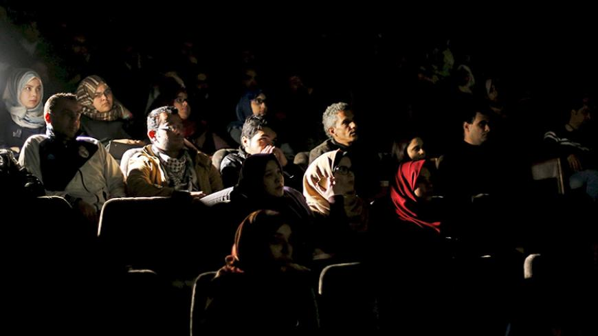 Palestinian spectators watch a movie at Red Crescent Society hall in Gaza City February 25, 2016. Palestinians in the Gaza Strip are enjoying their first night out at the movies since political tensions led to the torching of cinemas in the enclave 20 years ago.  Picture taken February 25, 2016. REUTERS/Mohammed Salem  - RTS8KNE