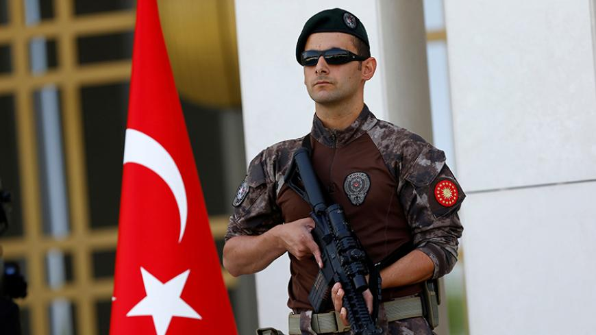 A Turkish special forces police officer guards the entrance of the Presidential Palace in Ankara, Turkey, August 5, 2016. REUTERS/Umit Bektas - RTSL6LJ