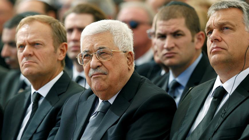 Palestinian President Mahmoud Abbas (C) sits alongside European Council President Donald Tusk (L) as they attend the funeral of Shimon Peres, 93, on Mount Herzl Cemetery in Jerusalem, September 30, 2016.  REUTERS/Abir Sultan/Pool - RTSQ58E