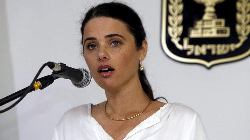 Ayelet Shaked, Israel's new Justice Minister of the far-right Jewish Home party, speaks during a ceremony at the Justice Ministry in Jerusalem May 17, 2015. Shaked said on Sunday she would seek a new balance that would rein in the powers of the Supreme Court over parliament and the government, a policy critics fear would restrict judicial oversight. REUTERS/Gali Tibbon/Pool - RTX1DBE4