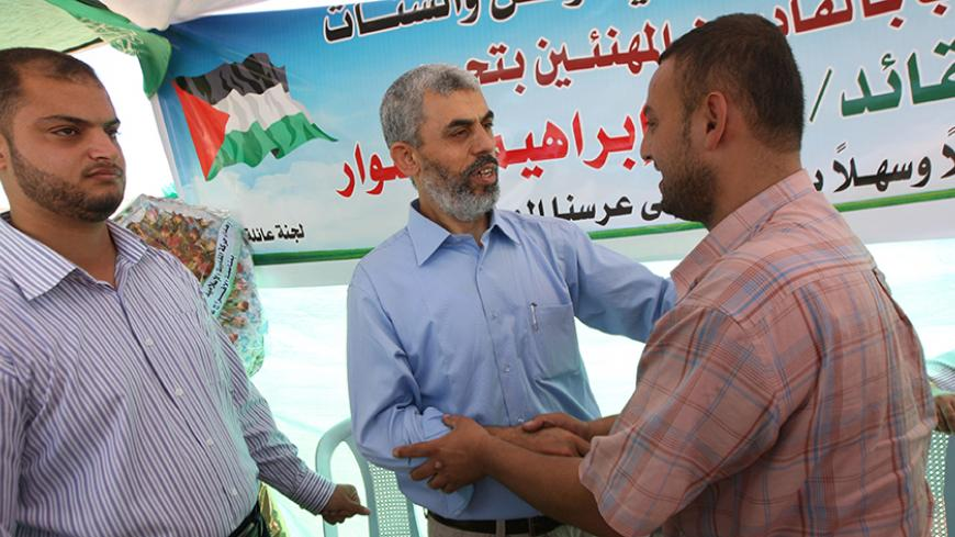 Freed Palestinian Hamas leader Yehia Sinwar (C) greets supporters following his release from an Israeli jail at a welcome tent near his home in Khan Yunis, southern Gaza Strip, on October 19, 2011. The Palestinian Hamas movement exchanged Gilad Shalit, the Israeli soldier who spent more than five years of isolation in a Gaza hide-out, for hundreds of Palestinian militants being held in Israeli jails. AFP PHOTO/SAID KHATIB (Photo credit should read SAID KHATIB/AFP/Getty Images)